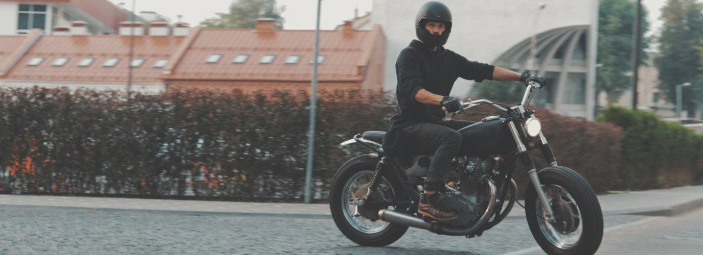 man riding his motorbike